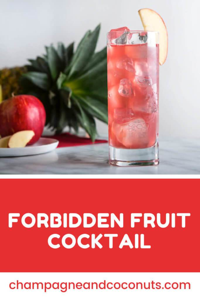 A cocktail served on a marble table with fresh fruit with text: Forbidden Fruit Cocktail