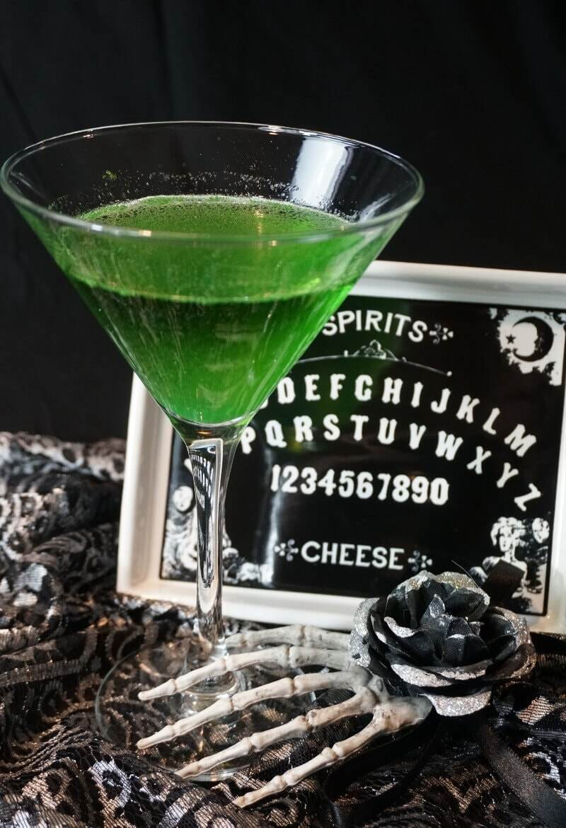 The Spirit Summoner Cocktail predicts you'll have a great Halloween. Fortune teller hand with ouija board