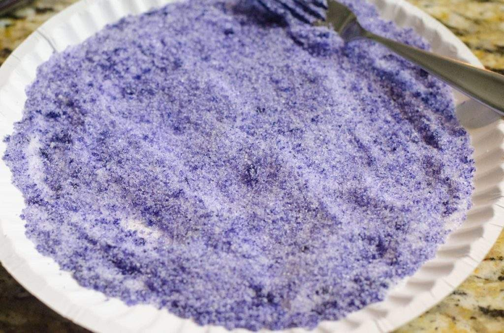 Purple tinted sugar used to rim a cocktail glass