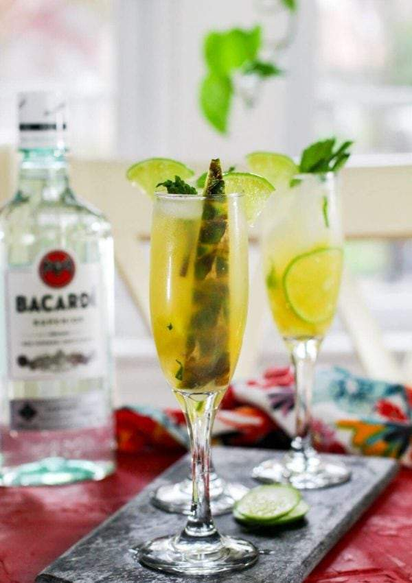 pineapple mojito garnished with pineapple spear