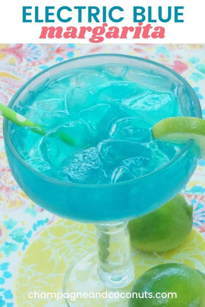 A blue cocktail on a yellow plate with limes on a printed tablecloth. Text: Electric Blue Margarita